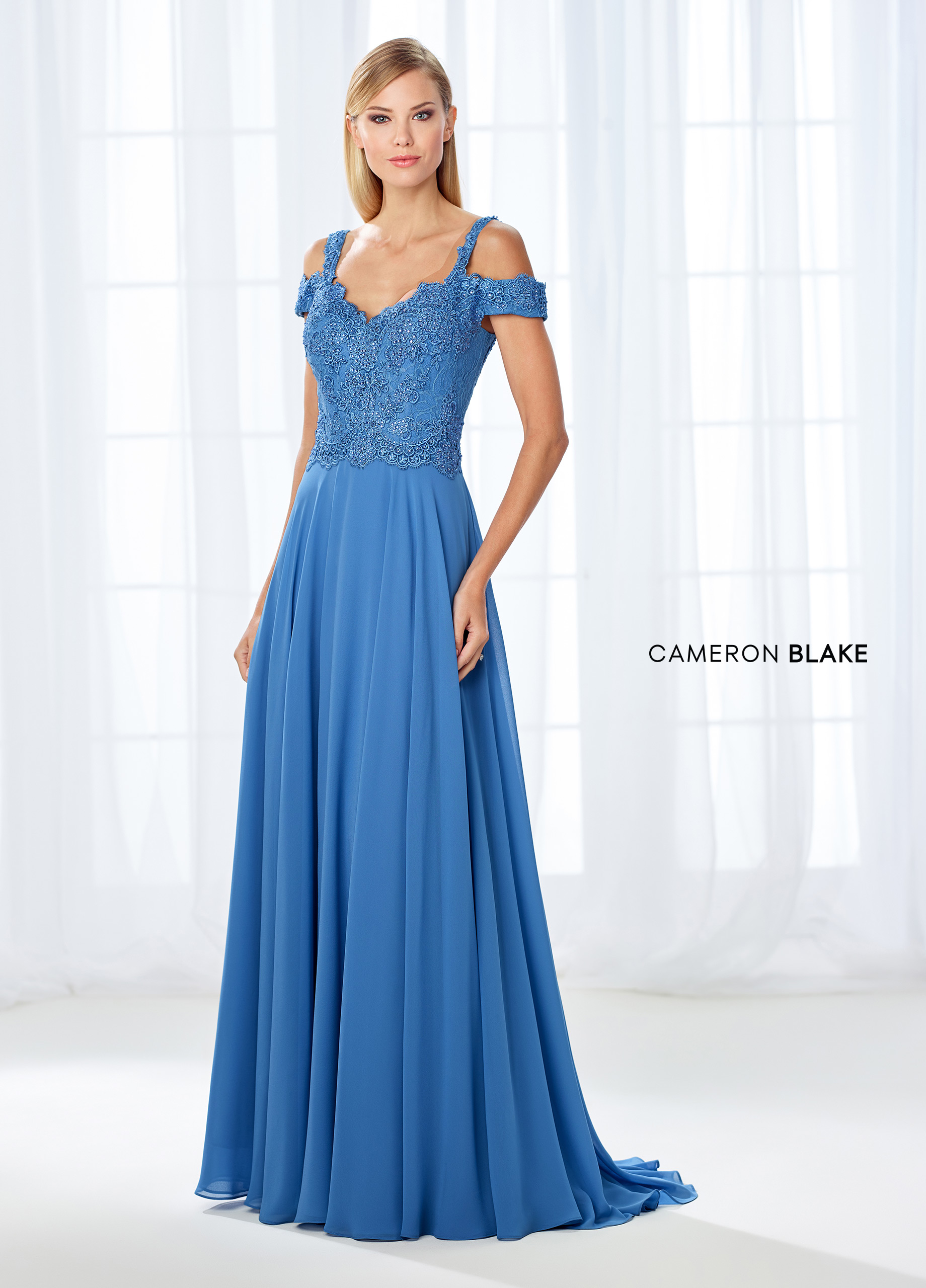 fcd84bb31f19 Simultaneously trendy and classic, this cold shoulder chiffon A-line gown  features a scalloped lace sweetheart bodice adorned with sparkling heat set  stones ...