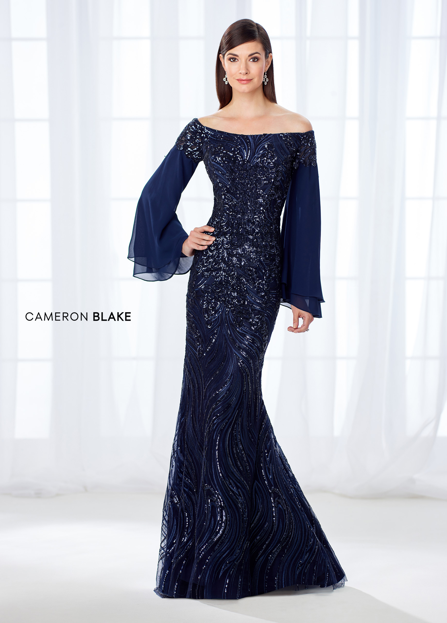 e84e7f20a812 A force to be reckoned with, this glamorous off-the-shoulder chiffon,  tulle, and intricately embroidered lace trumpet gown accented with heat set  stones and ...