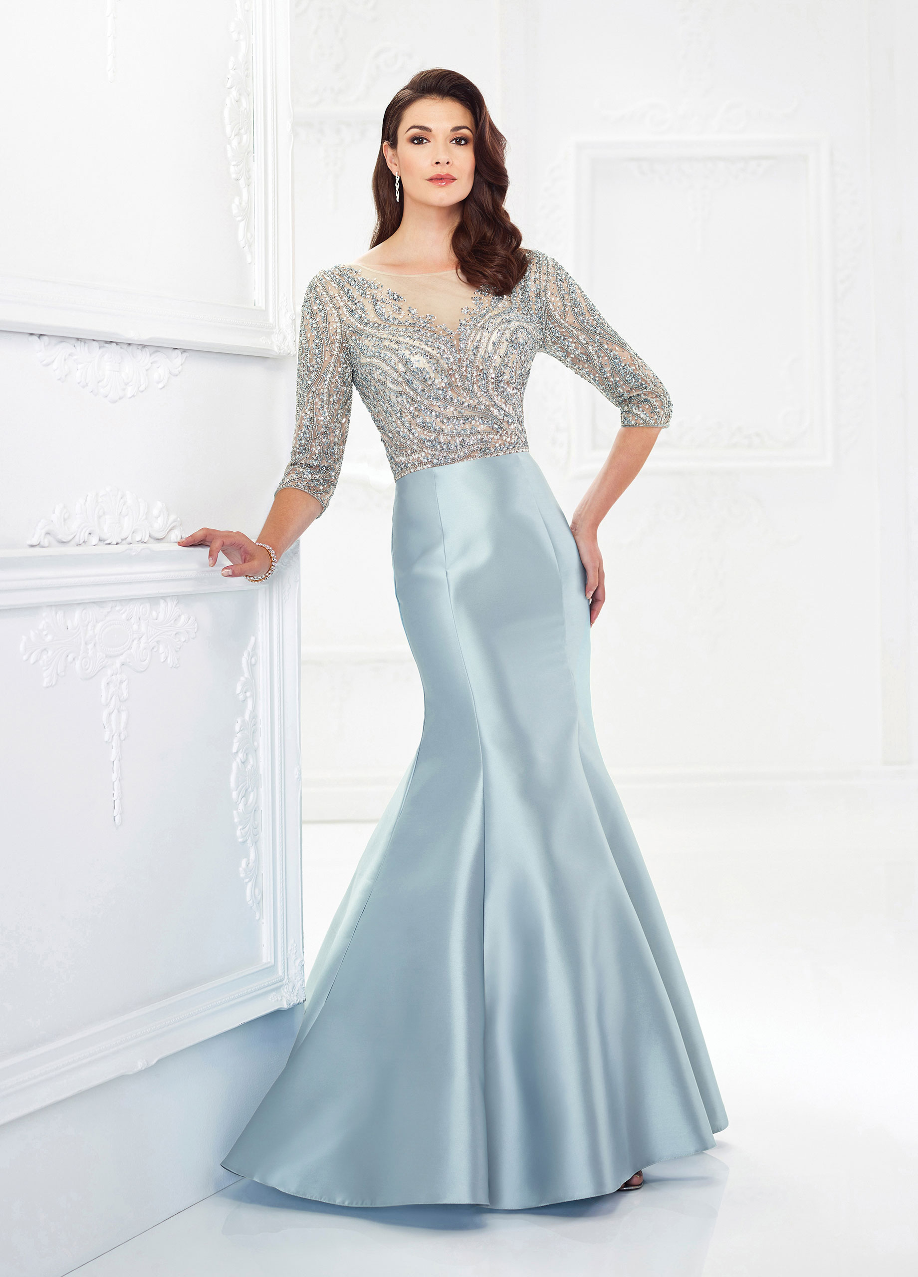 ae9d6029dcf It s impossible not to feel glamorous and gorgeous in this Mikado mermaid  gown with hand-beaded tulle three-quarter sleeves