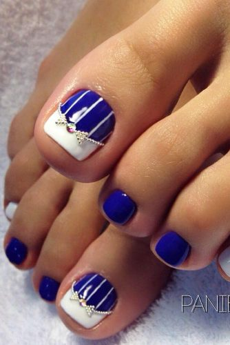 the pretty blue polish is dressy and the white tip and sparkly bow design on the big toe give this design a sophisticated look
