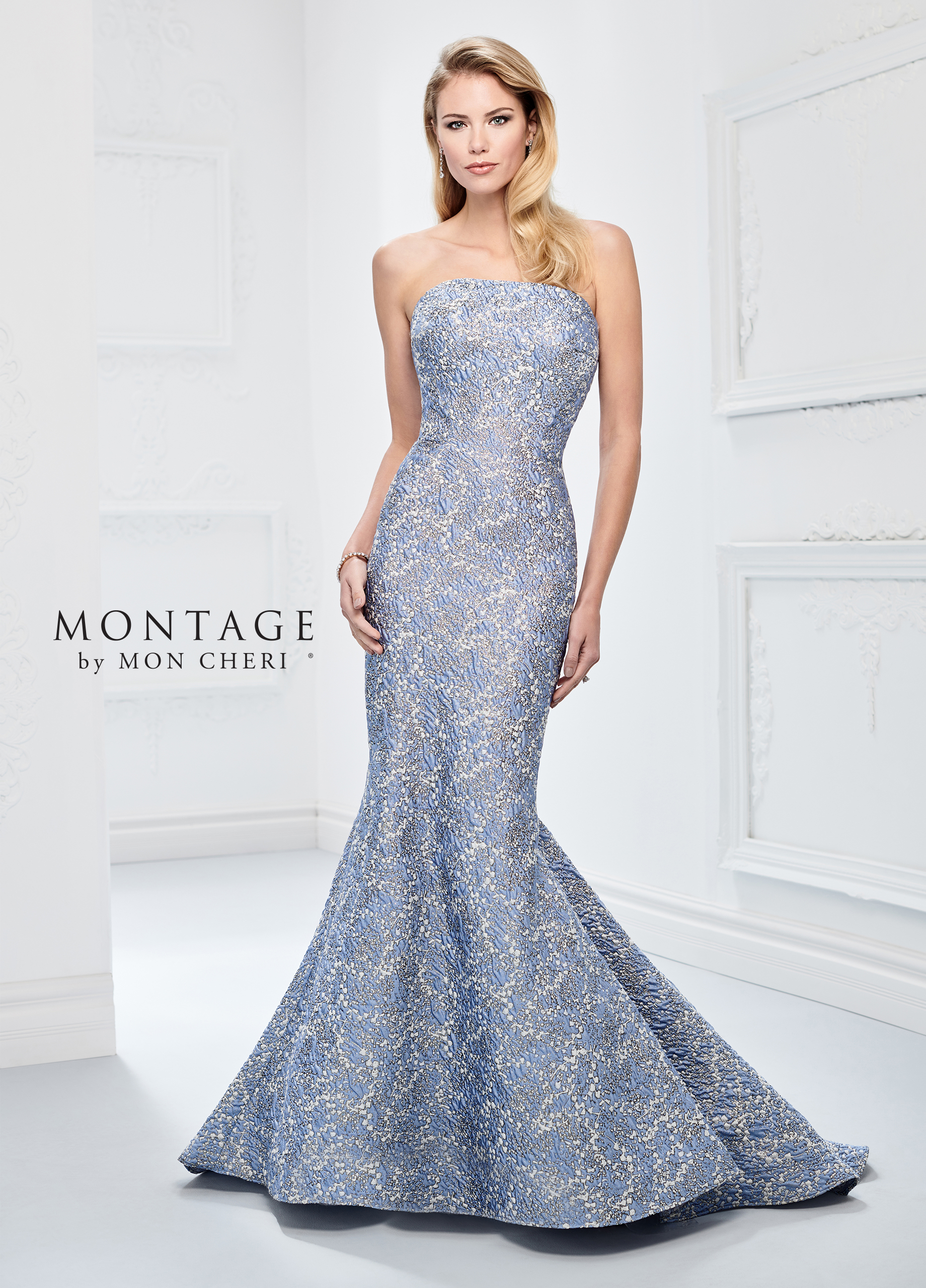 6bbe5ea4771 This strapless brocade curve-hugging mermaid gown with metallic accents  throughout offers a slightly dipped back
