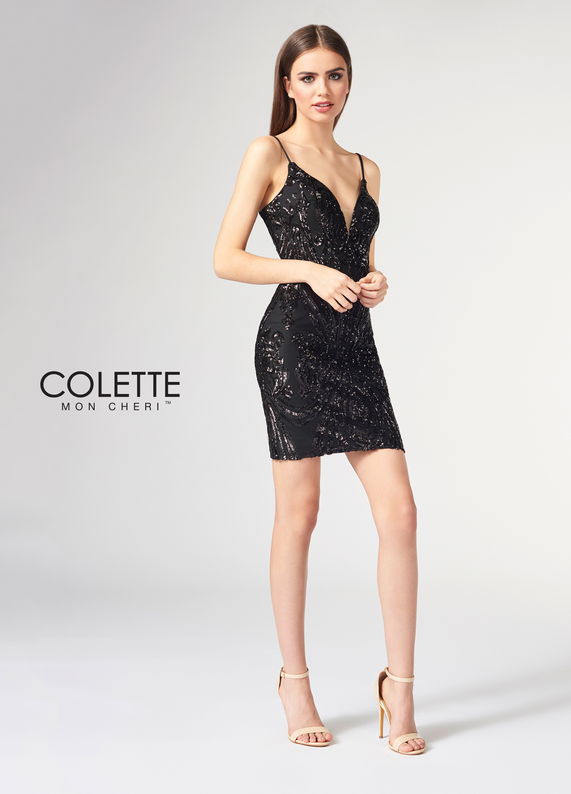 d4910376cc5 This decadent sleeveless sequin short sheath with spaghetti straps features  a curved plunging V-neckline with a sheer inset and a V-back.