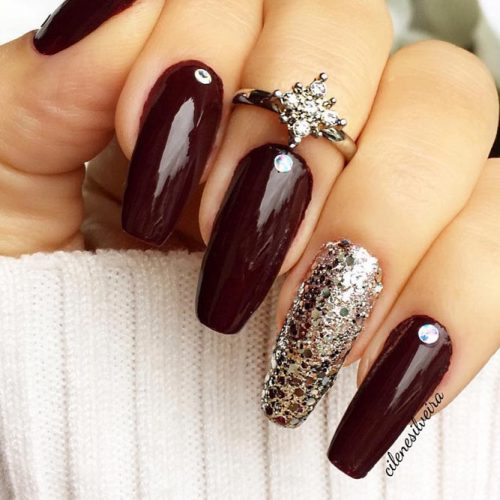 Burgundy is such a stunning Fall color. But if you pair it with gold  glitter polish on your ring finger, you'll have a look that's sleek and  sophisticated. - 45 MUST TRY FALL NAIL DESIGNS AND IDEAS – My Stylish Zoo