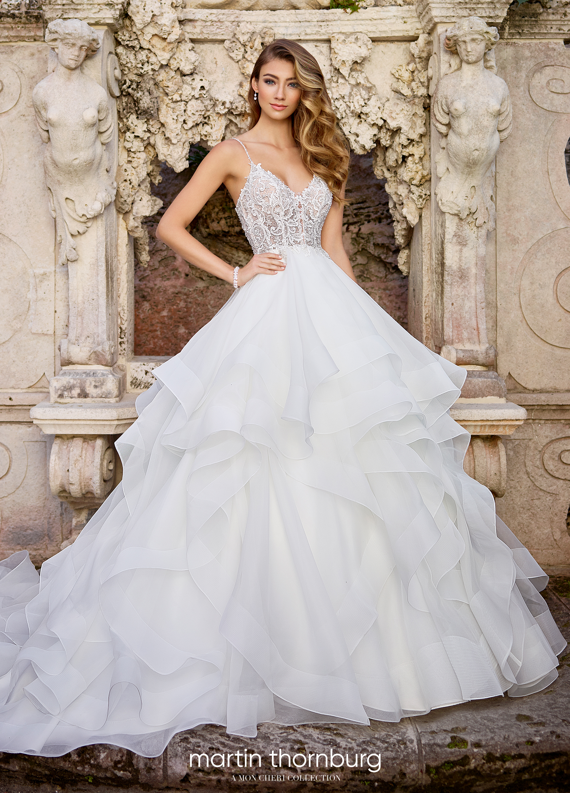1b14a5e95ce3 Luxurious, inspirational and Italian opera-appropriate, Adele is a  sleeveless lace and organza ballgown with hand-beaded spaghetti straps, a  beaded Venise ...
