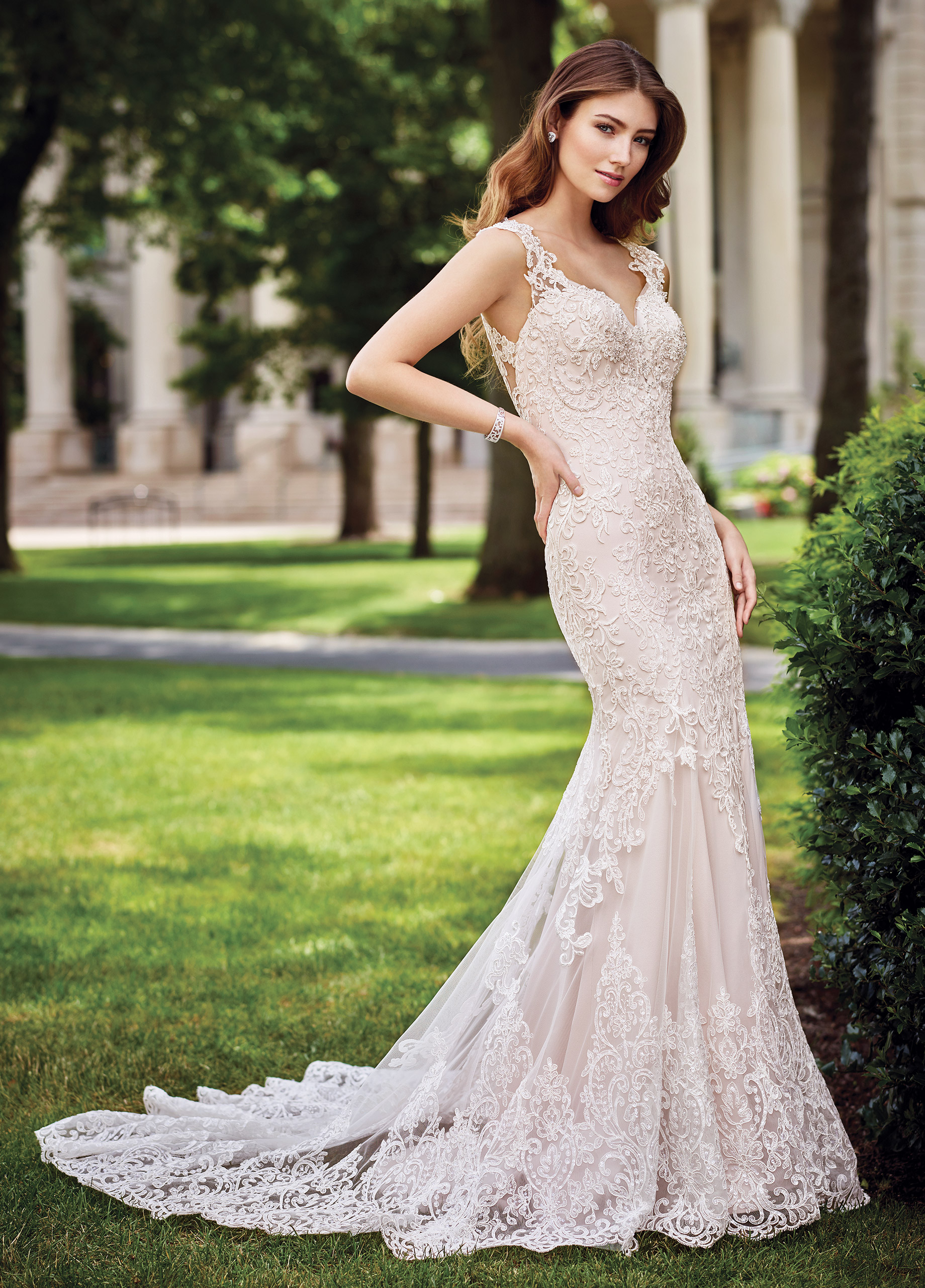 1b9e2316dea Re-embroidered Alençon lace on tulle over soft satin sheath with hand-beaded  illusion lace cap sleeves